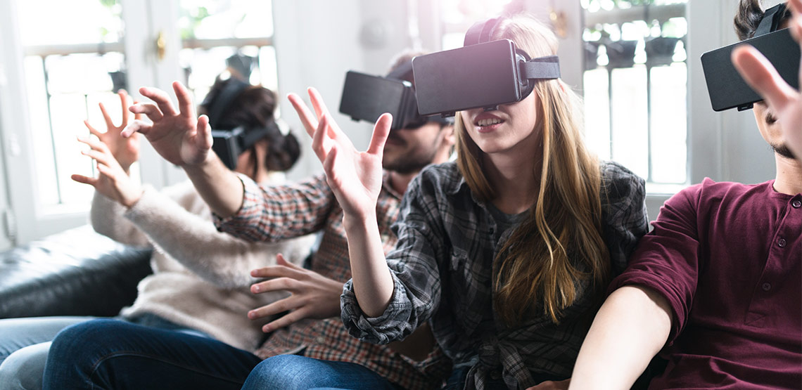 Group of friends with virtual reality headsets on