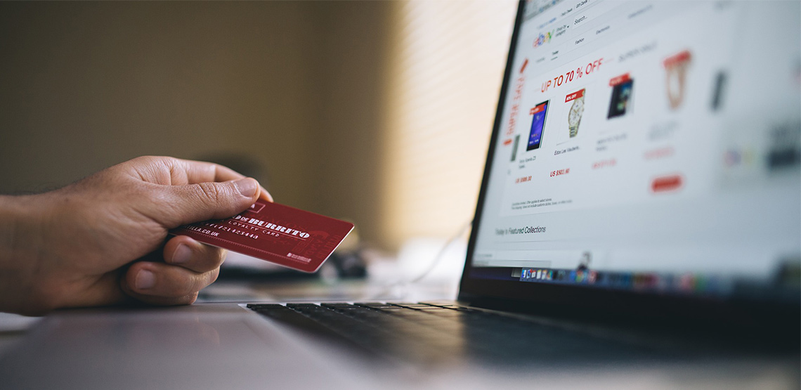 Person using credit card to buy something online
