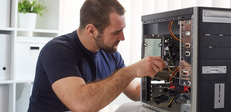 Man screwing something into a computer