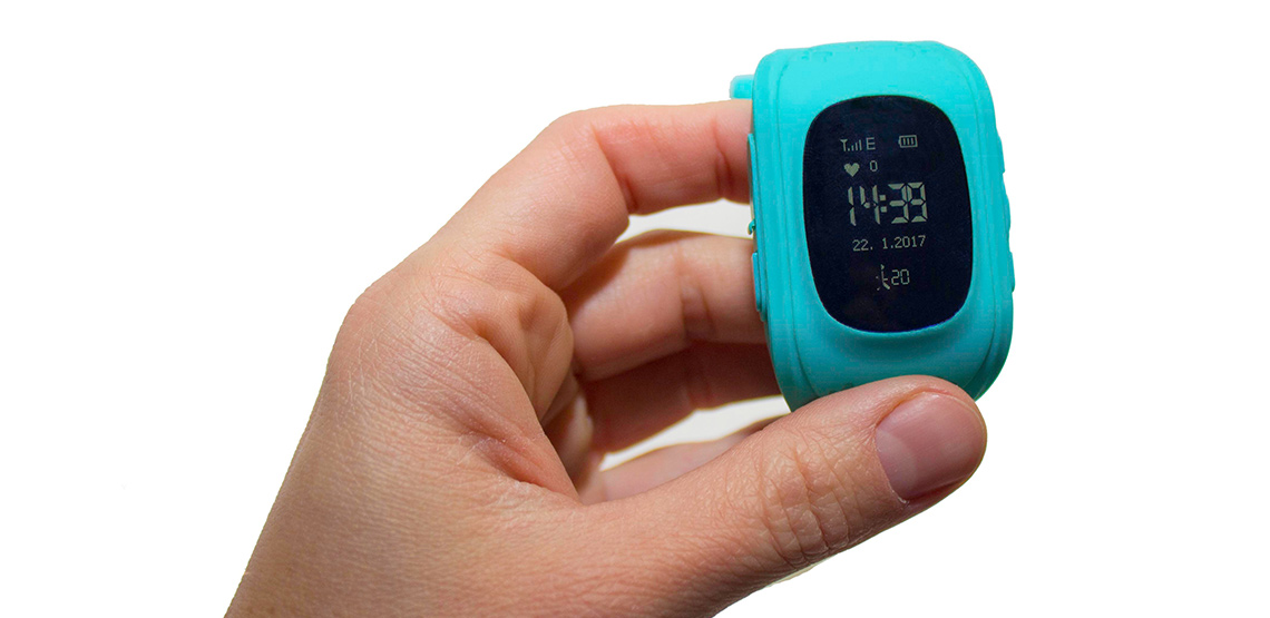 Person holding GPS tracking smart watch
