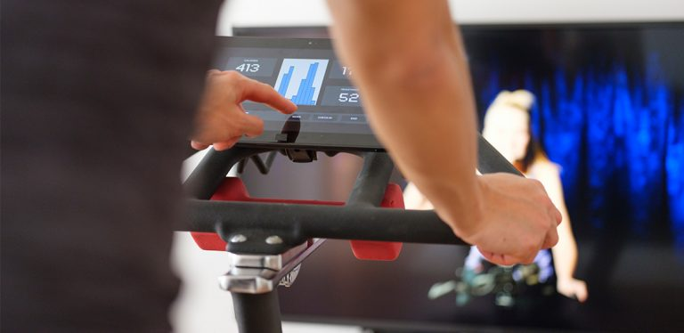 Person on exercise bike with a screen