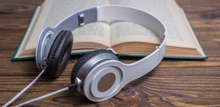 Headphones and an open book.