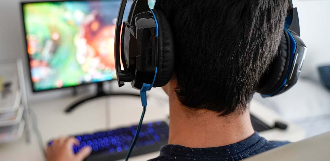 Someone wearing headphones playing an online game.