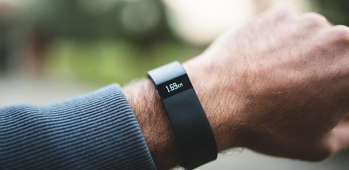 Fitbit on man's arm
