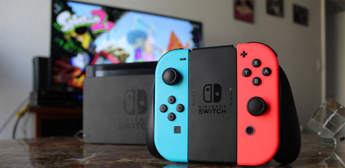 Nintendo Switch controller with TV in background