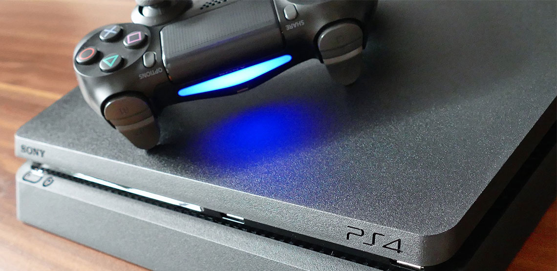 PS4 controller sitting on top of a PS4