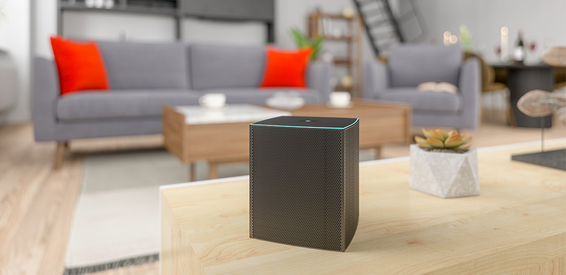 Wireless speaker sitting on a coffee table in a living room