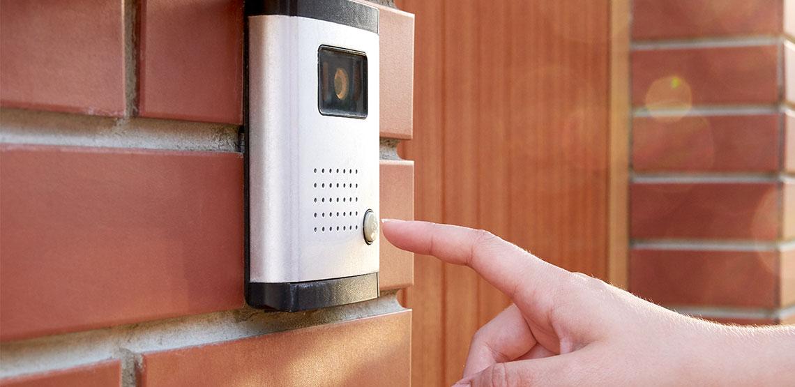 Someone reaching to ring doorbell