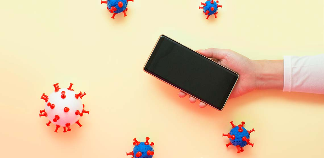 A black smart phone against a yellow screen with germ graphics around it.