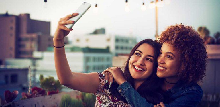 Two women taking a selfie.