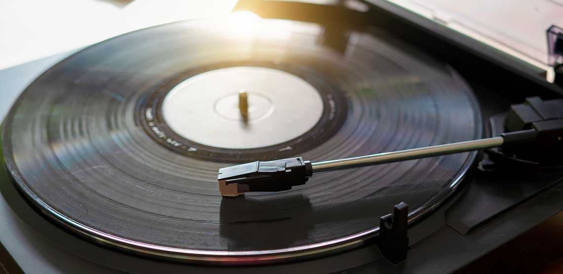 A black record on a record player.